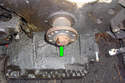 Remove the 36mm crankshaft pulley mounting bolt (green arrow).