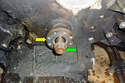 Remove the crankshaft bolt (green arrow) and the crankshaft pulley flange (yellow arrow) from the end of the crankshaft.