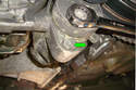 Remove the 13mm tensioner lower mounting bolt (green arrow).