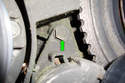 Remove the 13mm tensioner upper mounting bolt (green arrow).