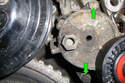If you want to remove the whole tensioner remove the two 13mm bolts (green arrows) that mount the tensioner to the engine block.