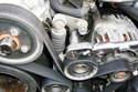 Remove the 13mm pivot bolt of the accessory drive belt tensioner.