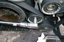 If you want to change the tensioner pulley only remove the 13mm bolt that secures it to the floating tensioner.