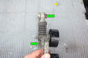 Pull the tensioner assembly away and remove the two 13mm nuts that mount the tensioner element to the assembly.
