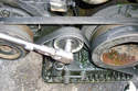 If you only want to replace the tensioner pulley for the AC belt remove the 13mm bolt that mount it to the tensioner.