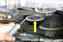 Hydraulic style tensioners, remove dust cap from tensioner pulley.