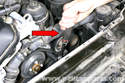 Locate accessory drive belt tensioner and remove dust cap (if necessary).