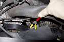 To release tension on the alternator (accessory) drive belt, loosen two 13mm tensioner fasteners (yellow arrows).