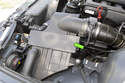 The 6-cylinder engine air filter housing is located in the left side of the engine compartment.