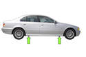 BMW E39 models have 4 solid rubber jacking pads, slightly behind front wheels and slightly in front of rear wheels.
