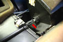 You should start to see the metal tang (red arrow) of the duct flap with the shaft moved all the way to the left side.