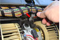 Pull the electrical connector wiring (red arrow) out of the way so you have room to remove the motor.