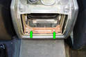 Remove the two Phillips head screws (green arrows) that mount the rear of the center console to the body of the car.