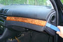 Using a plastic pry tool lever off the wood trim panel mounted in the center of the dash.