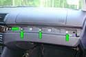 There are four Phillips head screws (green arrows) that need to be removed hidden behind the wood trim.