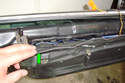 You can now start peeling away the vapor barrier that insulates the inner door panel.