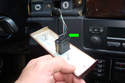 Squeeze the electrical connector (green arrow) and pull straight out to unplug the cruise control switch.