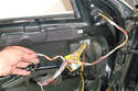 Start to untangle the wiring for the mirror from the door harness.
