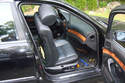 It is easier to move the seat all the way forward and tilt the top of the seat out of the door.