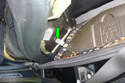 Lift the cushion straight upwards to unseat the metal tab (green arrow) that hold the bottom down.