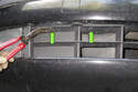 Working under the front bumper, remove trim panels clips (green arrows).