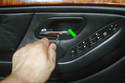 You may have to pop off this cover (green arrow) to expose the second Phillips screw in the center of the door handle cover.