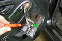 On the lever lock push down on the center tab (green arrows) and slide the lever over it all the way approximately 90°.