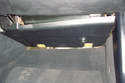 There is a lower panel underneath the glove box in the foot-well area.