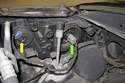 Working at rear of headlight assembly, unplug headlight bulb electrical connector by squeezing release tab and pulling off.