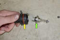 Low beam bulb: Pull headlight bulb (green arrow) out of bulb holder (yellow arrow).