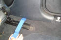 Use a plastic pry tool to lever out the clips that hold on the bottom of the B-Pillar cover.