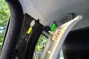 At the top of the panel is a single securing clip (green arrow) that fits into a plastic receptacle (yellow arrow).
