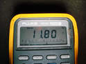 You should read battery voltage on your meter.