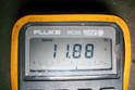 Your meter should read either positive battery volts or negative battery voltage.