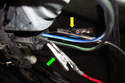 Install test pins and attach your red positive test lead (green arrow) and your black test lead (yellow arrow) to the power motor wiring so you can measure the direction of voltage to your motor.