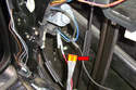 You can use a fused jumper wire (red arrow) to run power and ground directly from the battery to the motor.