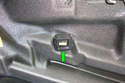 There is a door clip (green arrow) mounted on a bracket in the center of the door frame.