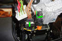 Unplug the two connectors from the steering column switch by squeezing each connector and pulling them straight out towards the rear of the car.
