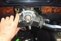 You can now slide the switch assembly downwards or spread it apart (it is a lightly flexible plastic) and remove it from the steering column.