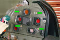 Remove the four 8mm fasteners (green arrows) that secure the lens to the body.