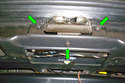 Remove the three T30 Torx screws (green arrows) that mount the trunk latch to the trunk.