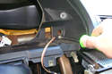 Working at the right side of the instrument cluster enclosure, remove the Phillips head screw.