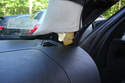 With the A-pillar cover popped off pull it straight up to remove it from its dash mount.