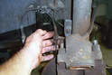 Get a firm grip of the wheel speed sensor harness and pull it out of the bracket that mounts it to the strut.