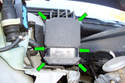 Facing the ABS/ASC module locate the six T20 Torx fasteners (green arrows) that mount the module to the hydraulic unit.