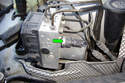 Locate the brake pressure switch (green arrow) on the backside of the ABS/ASC hydraulic unit.