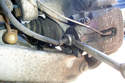 Use a 14mm wrench to thread the brake line out of the caliper.