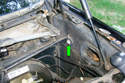Remove the 10mm mounting fastener (green arrow) that holds on the brake booster cover.