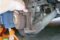 Remove the brake caliper bracket from the rear assembly.