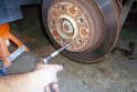 Remove the 5mm Allen head fastener that secures the brake rotor to the rear axle flange.